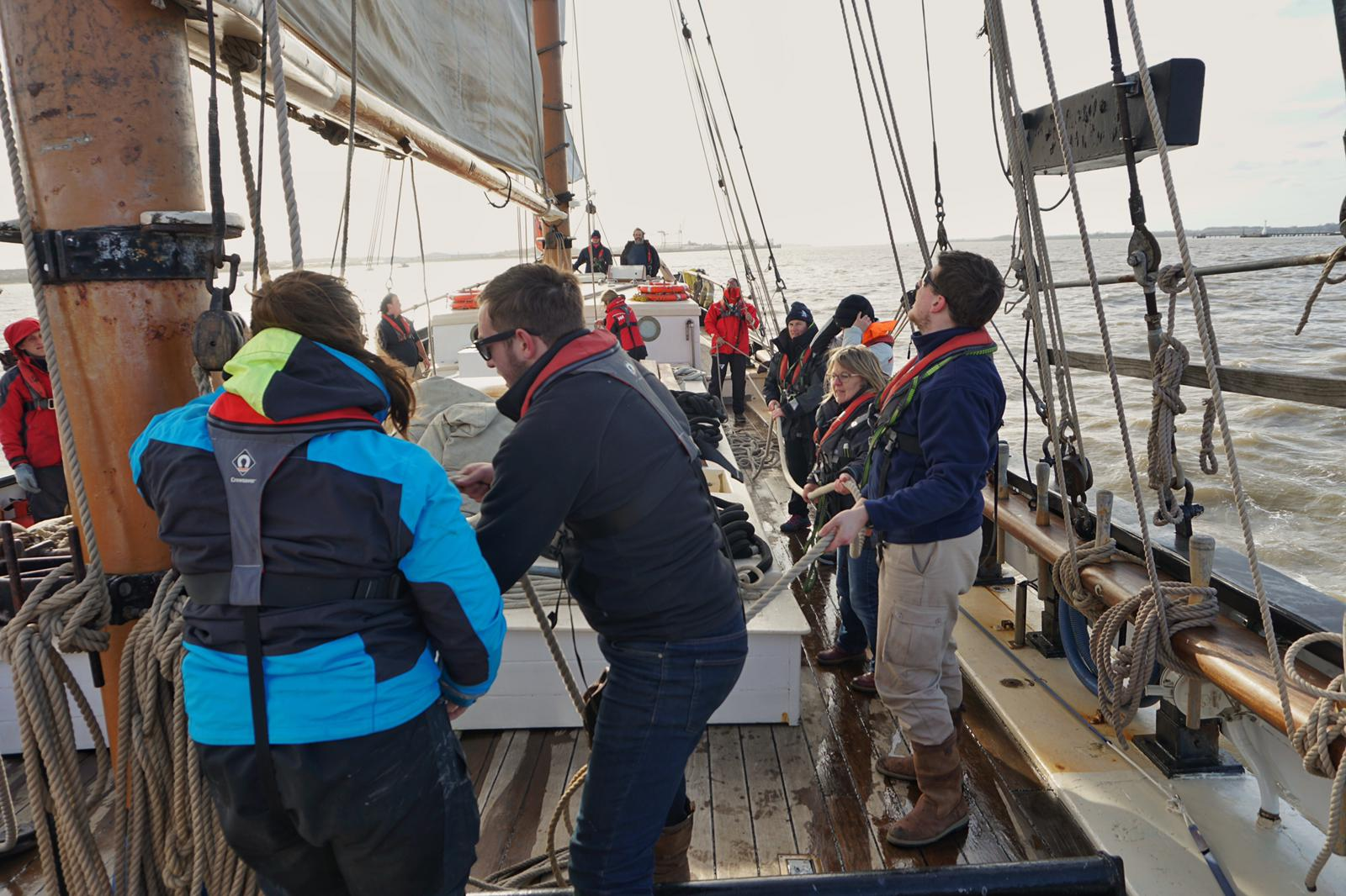 Team hauling sails